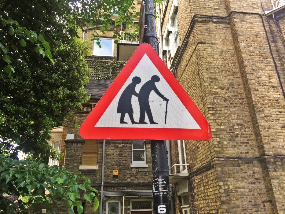 a road sign symbolises procrastination